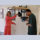 05 - My wife (Denise) showing Mohammad Ali how to use the speed bag.